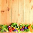 Fresh vegetables with spring flowers — Stock Photo #18672439