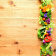 Fresh vegetables with spring flowers — Stock Photo #18672441