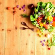 Fresh vegetables with spring flowers — Stock Photo #18672643