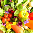 Fresh vegetables with spring flowers — Stock Photo