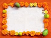 Marigold,mango,orange and incense.frame.on orange background — Stock Photo