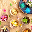 Tropical flowers and Asian spa supplies — Stock Photo