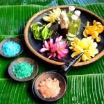 Tropical Asian flowers with bath salt.banana leaf background — Stock Photo