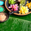 Tropical Asian flowers with bath salt.banana leaf background — Stock Photo