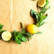 Wreath of lemon and herbs - Stock Photo