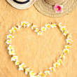 Straw hats with heart shaped of plumeria - Stock Photo