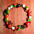 Fresh Vegetables.wreath.on brown wood background — Stock fotografie