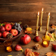 Autumn fruits with candles — Stock Photo