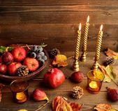 Autumn fruits with candles — Stockfoto