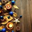 Blue Christmas ornaments with gold leaves — стоковое фото #32102263