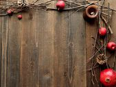 Winter fruits,candles and twigs — Стоковое фото