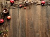 Winter fruits,candles and twigs — Stock fotografie