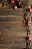 Winter fruits,candles and twigs — Stock Photo