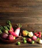 Colorful root vegetables with spring vegetables — Stock Photo