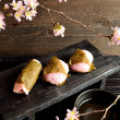 Japanese cake with cherry blossoms — Stock Photo #40129479