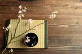 Cherry blossoms on Japanese tatami mat — Stock Photo