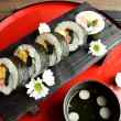 Sushi roll on Japanese red tray — Stock Photo #40280935