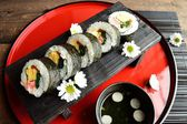 Sushi roll on Japanese red tray — Foto Stock