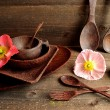 Wooden table ware with poppies — Stock Photo #41174079