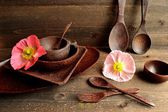 Wooden table ware with poppies — Stock Photo