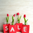 Stock Photo: Red bargain sale shopping bag with tulip