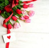 Bouquet of pink tulips with message card — Stock Photo