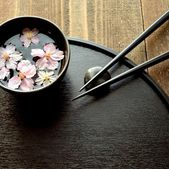 Small bowl of cherry blossoms with chopsticks — Stock Photo