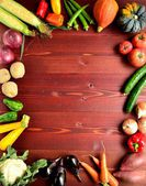 Summer vegetables on brown wooden background — Stock Photo