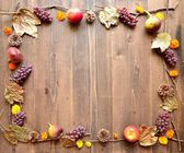 Autumn fruits with yellow cosmoses — Stock Photo