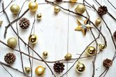 Gold Christmas ornaments with star — Stock Photo