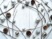 Silver Christmas ornament balls with pine cones — Stock Photo
