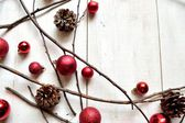 Red Christmas ornament balls with pine cones — Stock Photo