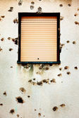 Bullet holes in a house facade — Stockfoto