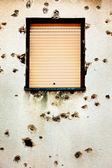 Bullet holes in a house facade — Stock Photo