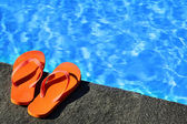 Sandals by a pool — Stock Photo