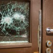 Broken window on door by vandalism — Stock Photo