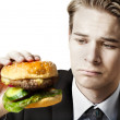 Businessman eating at work — Stock Photo