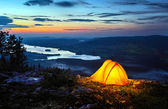 A tent lit up at dusk — Stock Photo