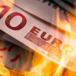 Euro banknotes burning — Stock Photo