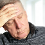 Senior man with a headache — Stock Photo