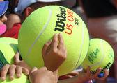 Children with big tennis balls — Stock Photo