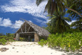 The island of dreams. Rest and relaxation. Big bungalow on sandy — Stock Photo