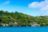 Several hotels on green shore of La Digue island, Seychelles. — Stock Photo