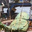 Fishing vessel. Great catch of fish in thrall. — Stock Photo