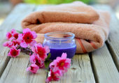 Towel candle flowers — Stock Photo