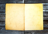 Vintage photos paper old book retro style wooden background — Foto de Stock