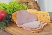 Smoked meat and cheese — Stock Photo
