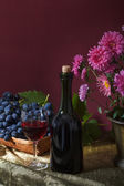 Still life with fruit and a bottle of wine — Stock Photo