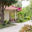 Stock Photo: Bungalows in tropical garden