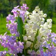Lily of the valley and lilac bouquet — Stock Photo